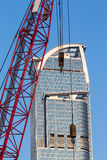 Crane with Skyscrapers Royalty Free Stock Images