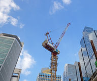 Crane among skyscrapers Royalty Free Stock Photo