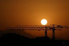 crane stali za słońca fotografia royalty free