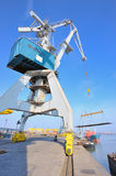 Crane and steel plate in harbor Stock Photos