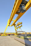 Crane and steel plates Stock Photo