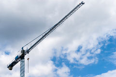 Crane straight to heaven. Connected to building industry or as a symbol of going up to the sky or to heaven Stock Images