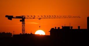 Crane and the sun Stock Photos