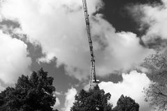 Crane sun built buildings and houses construction industry structure metal Royalty Free Stock Image
