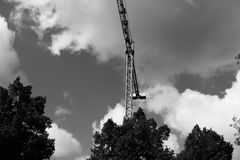 Crane sun built buildings and houses construction industry structure metal Stock Photos