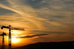 Crane in sunset. Beautiful panorama of crane in orange sunset royalty free stock photography