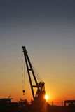 Crane on sunset. The silhouette of crane on sunset Royalty Free Stock Photos