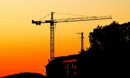 Crane in the sunset with orange and yellow stock image
