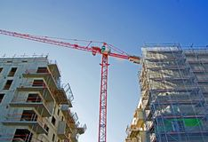 Crane surrounded two buildings Stock Photography