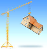 Crane with suspended house Stock Images