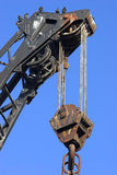 Crane, Tackle 1. Photo of the lifting tackle, pulley wheels and cables on an industrial crane. Clear blue sky behind Royalty Free Stock Image