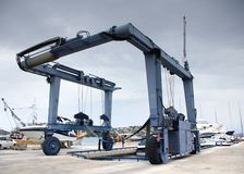 Crane to lifting boats at harbor, marina Royalty Free Stock Photos