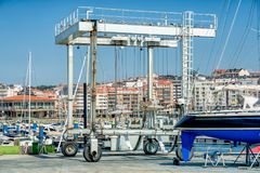 Crane to lifting boats at harbor or marina. For maintenance and repair Royalty Free Stock Images