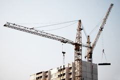 Crane on top of building Stock Images