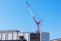 crane on top of construction building Royalty Free Stock Image