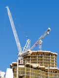Crane on top of new condo tower Stock Photo