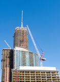 Crane on top of new condo tower Royalty Free Stock Photo