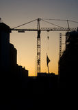 Crane tower. Silhouette of a crane tower at sunset Stock Image