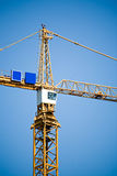 Crane tower against blue sky Stock Photos