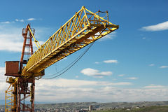 Crane tower against a blue sky Royalty Free Stock Photography