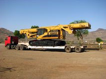 Crane Trailer. A huge trailer truck carrying a new tlarge crane Royalty Free Stock Photos