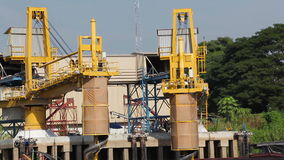 Crane transfer load goods on conveyor belt into ship for transportation stock video