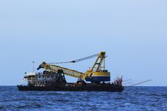 Transportation of crane trucks in the sea royalty free stock images