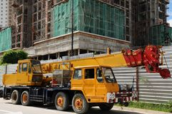 Crane truck. Mobile crane truck at the under construction side Royalty Free Stock Photos