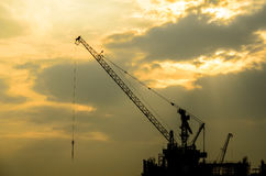 The Crane Truck. Has under construction under the lighting sky in the evening Stock Photography