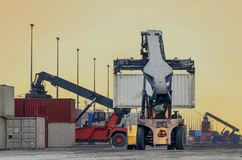 Crane truck lift container in warehouse . Crane truck lift container in warehouse at thailand Royalty Free Stock Images