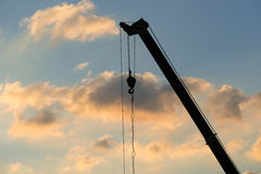 Crane Truck. Mobile crane operating, silhouettes at sunset Stock Photo