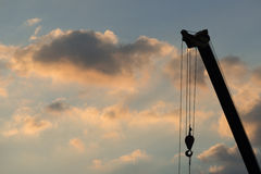 Crane Truck. Mobile crane operating, silhouettes at sunset Stock Photography