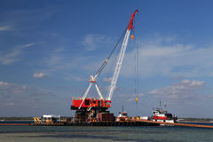 Crane and Tug Boats Installing Pipeline Royalty Free Stock Photography