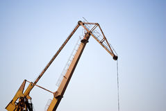 Crane under blue sky at the construction site Royalty Free Stock Images