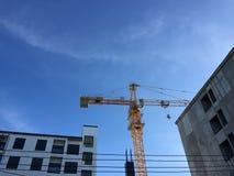 Crane under blue sky Stock Photos