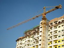Crane and unfinished building royalty free stock photography