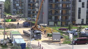Crane unload block from truck trailer in construction site stock video footage