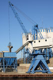 Crane unloading sand in a silo Royalty Free Stock Photography