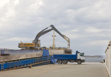 Crane unloads a ship in a truck in the port Stock Photography
