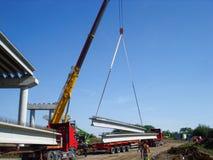 The crane unlods truck stock photos
