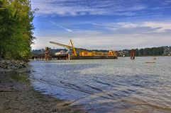 Crane vessel on Fraser river Royalty Free Stock Images
