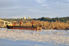 Crane vessel on the icy river Stock Photography