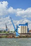Crane vessel moored in Port of Rotterdam on a sunny day royalty free stock images