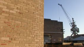 Crane and wall shot. A medium shot of a crane and wall stock video footage