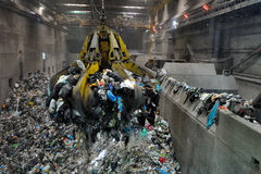 Crane in waste to energy power plant. Crane for garbage in a waste to energy power plant in Brescia, Italy stock image