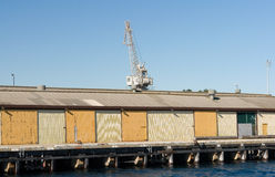 Crane on wharf cargo sheds Stock Photography
