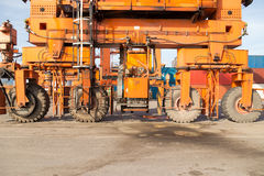Crane wheel. Detail view of container loader crane from the seaport Royalty Free Stock Photos