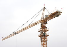 Crane on white background. Building crane and the white background Royalty Free Stock Photo