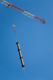 Crane at work. Crane holding a prefabricated element against a limpid sky Royalty Free Stock Photo