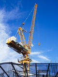 Crane work in construction site with blue sky background Royalty Free Stock Photos